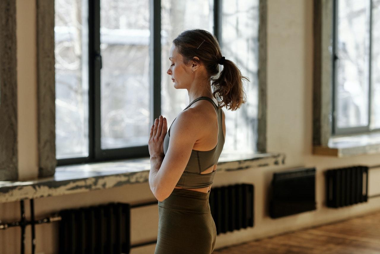 photo of woman meditating alone 4057333